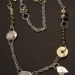 Silver, Brass, Glass, Coin and 18K Gold - $250